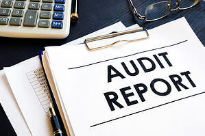 Audit Report With Business Documents in an Office