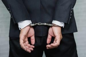 Businessman_Handcuffs