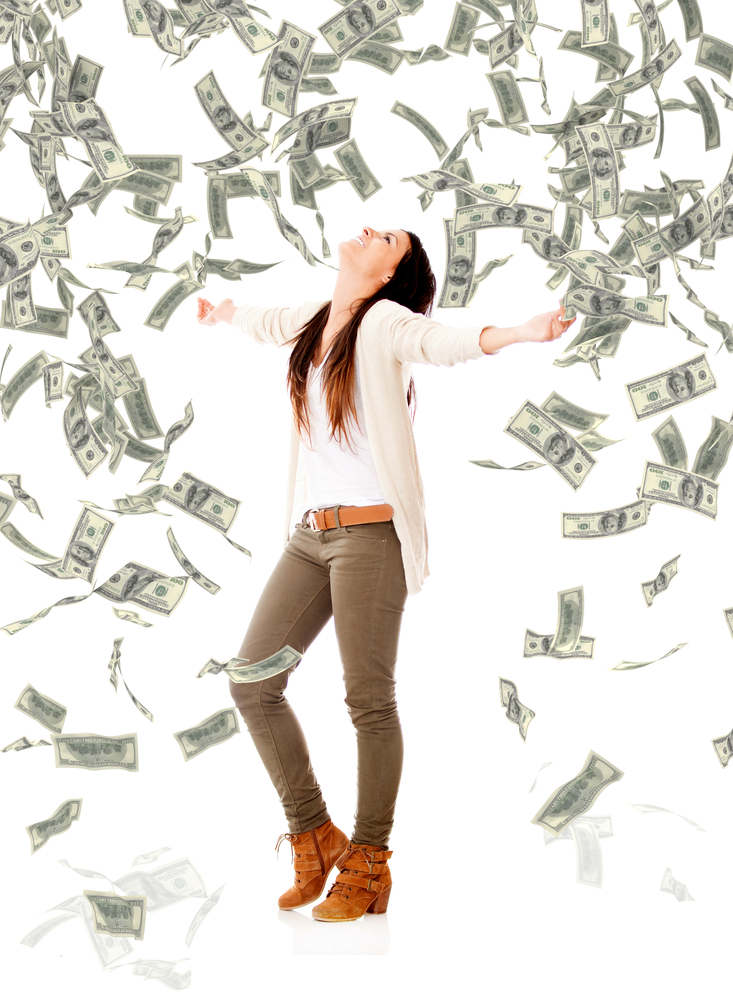 Excited woman under a money rain - isolated over a white background-1