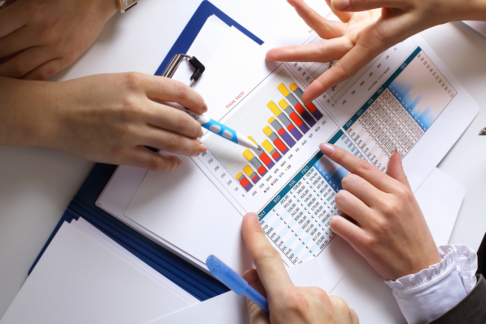 Financial paper charts and graphs on the table-1