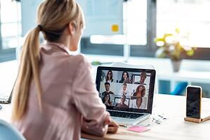Female Employee Speaking on Video Call With Colleagues With Laptop at Home