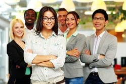 Smiling group of co-workers standing in office