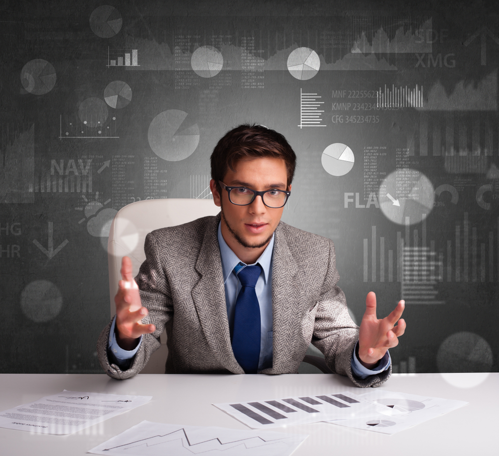 Young manager at the office making report and statistics with blackboard background-1