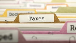 Taxes Concept on File Label in Multicolor Card Index. Closeup View. Selective Focus.