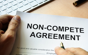 Man Signing a Non-Compete Agreement
