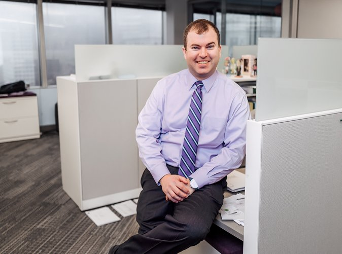 professional man standing at desk