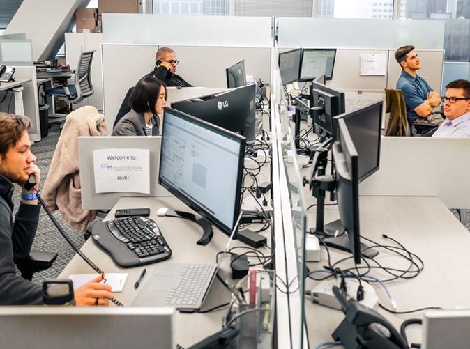 Meaden and Moore office employees at their desks working on computers