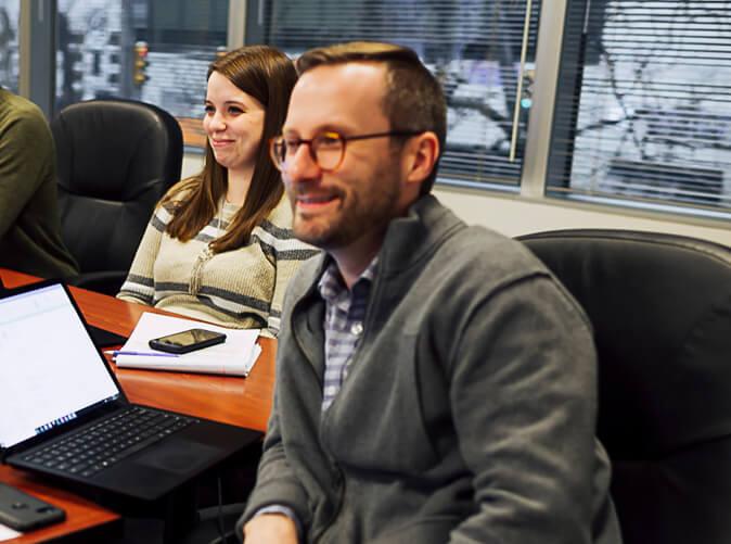 team members meeting in conference room