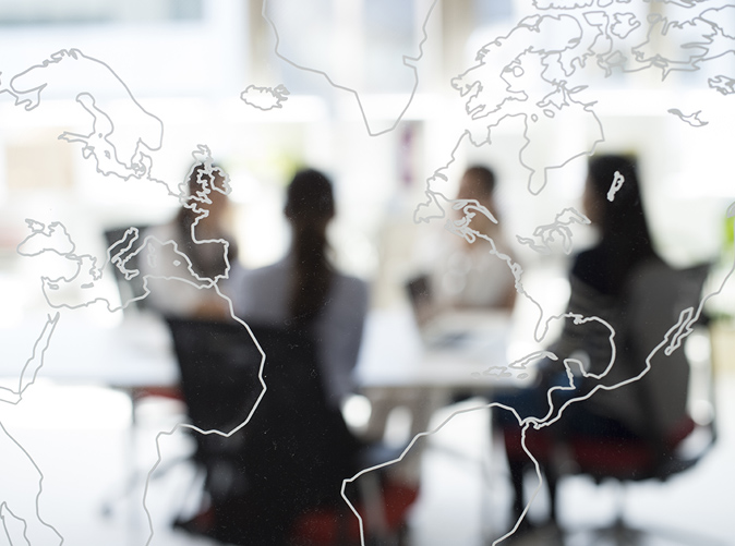 world map overlay professionals meeting at conference table