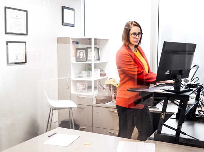 Meaden & Moore accounting professional using standing desk