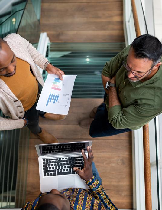three men meeting in an office stairway