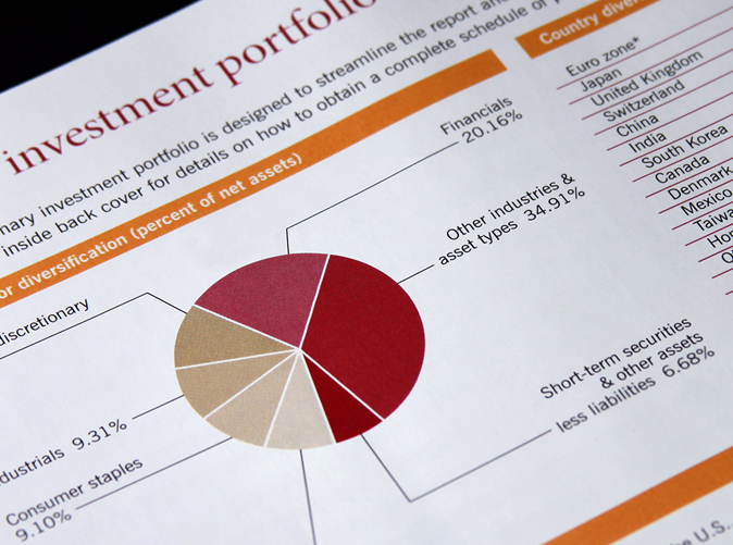 piece of paper showing investment portfolio with diversification chart