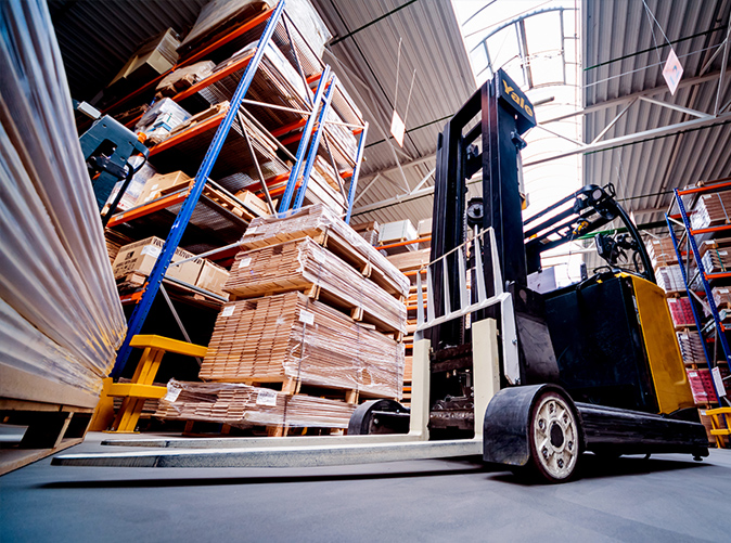 forklift moving materials in warehouse