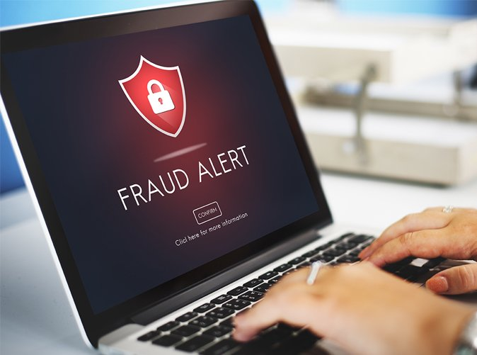 fraud alert displayed on laptop screen