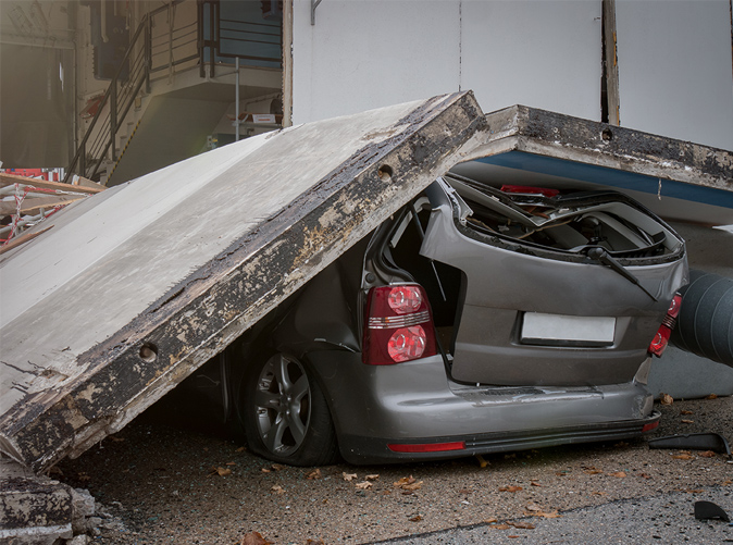 car crushed by concrete slab