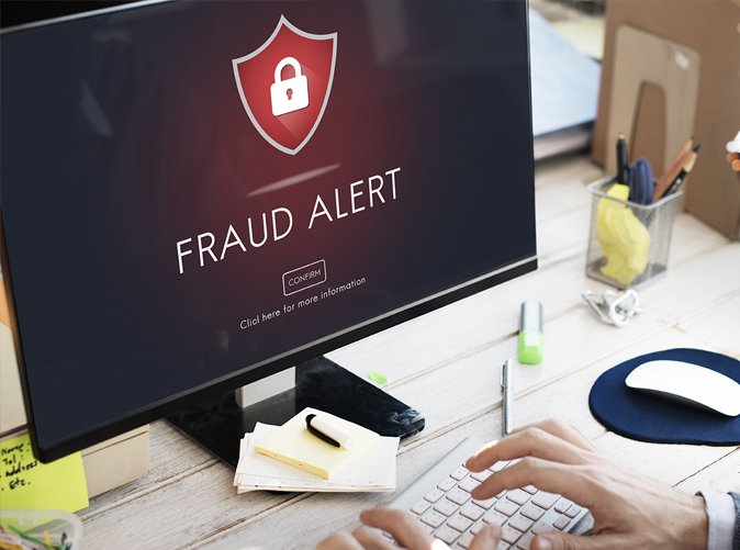fraud alert displayed on computer screen