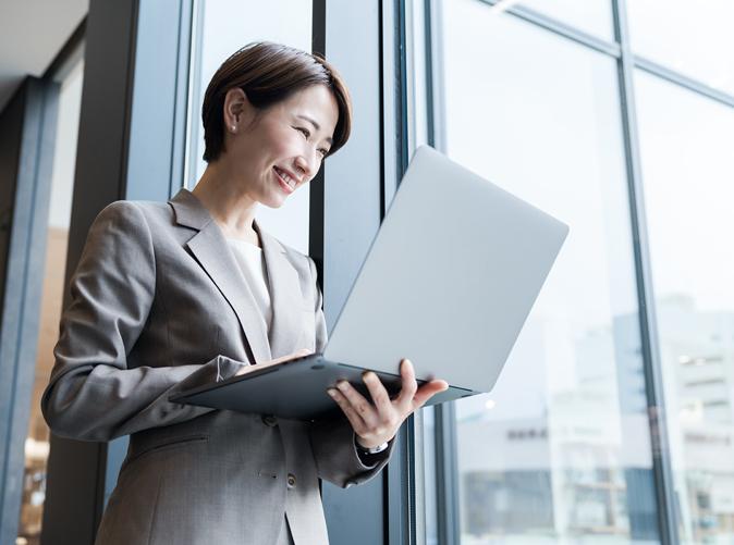 professional woman holding laptop